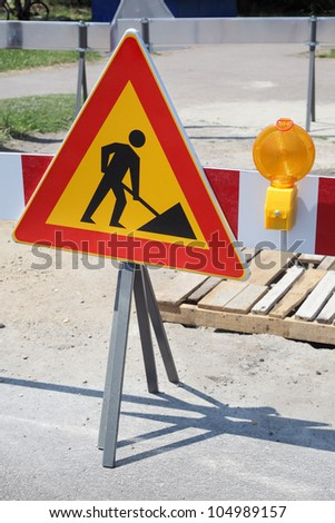 Road signs in a street under reconstruction