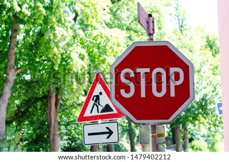 Road signs, stop sign roadworks sign