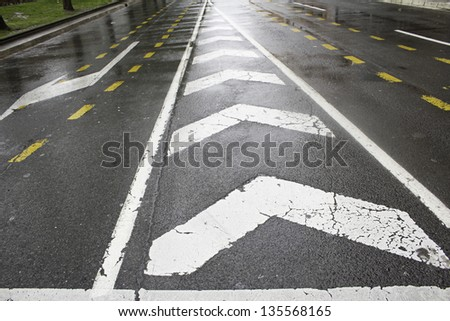 Road Signs with arrows wet conditions and transport regulations - stock photo