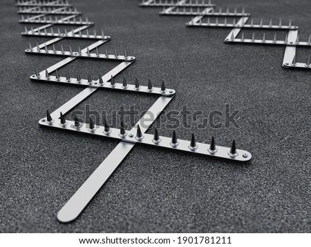 Road spike or tire trap on asphalt background. 3D illustration. Stock photo ©