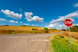Road Stop Sign before the Intersection in Tuscany, Italy