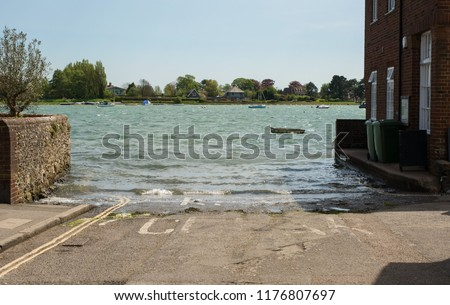 Road submerged under high tide at Bosham in Chichester Harbour, West Sussex, England #1176807697