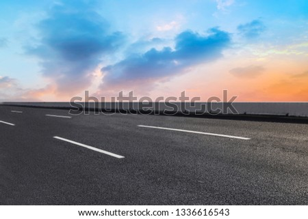 Road surface and sky cloud landscape #1336616543