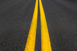 Road texture with two yellow stripes