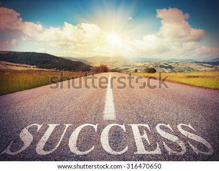 Road that says success in the asphalt