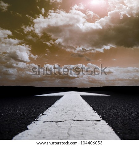 road through a field at sunset - stock photo