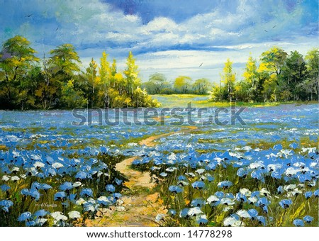Road through a field with blossoming cornflowers