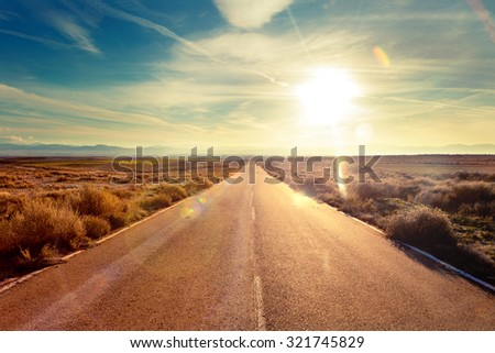 Road through landscape. Road and car travel scenic and sunset.Road travel concept.Car travel adventures.