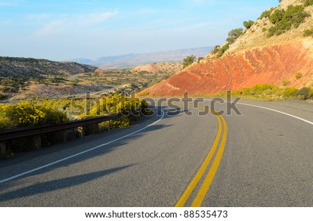 road through painted desert in Big Canyon National Recreation Area - stock photo