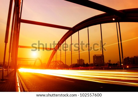 road through the bridge with blue sky background of a city