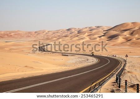 Road through the desert to the Moreeb dune in Liwa Oasis, Emirate of Abu Dhabi, UAE
