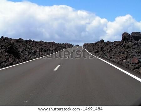 Road through the lava rocks. Lanzarote, Canary Islands.