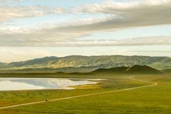 Road Through Wonderland - Soda Lake Road leads visitors through Carrizo Plain. Carrizo Plain National Monument, California, USA
