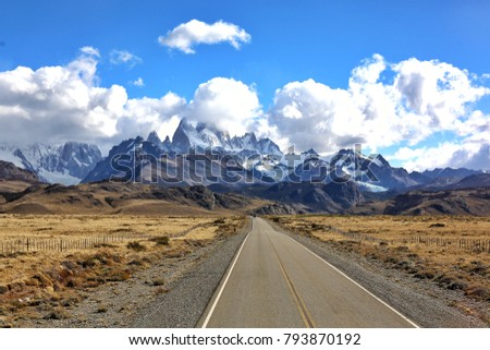 road to el chalten, argentina, patagonia with fitz roy snow mountain and yellow grass field