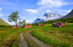 Road to mountain cabins landscape. Mountain cabins view. Mountain red cabins landscape. Mountain cabins