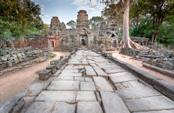 Road to old Buddhist temple in Cambodia, the 12th century. Ancient Angkor complex. UNESCO world heritage site.