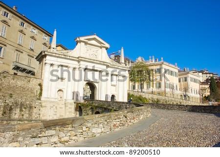 road to old city gate Porta San Giacomo, Bergamo, Italy
