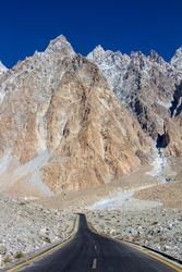 Road to Passu cones the world famous spikey mountains on Karakoram Highway Upper Hunza GB Pakistan
