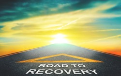 Road to recovery concept for business and health concept with golden nature sky background.