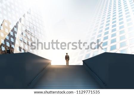 road to success concept with businessman climbs up the stairs among business buildings in the city