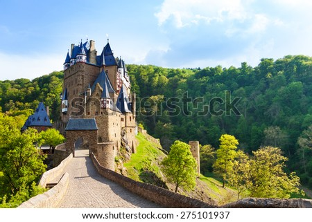 Road to the Eltz castle with towers, in hills