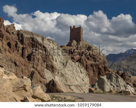 Road to the ruins of the ancient Tibetan Basgo monastery, towering on a mountainside burgundy color towers a pink brick building, Ladakh, Northern India. #1059179084