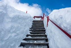 Road to the sky: Winter resorts are mostly covered with snow. It is beautiful to look around and walking through snow roads. When you walk a stairs like this, you will feel like walking to the sky.