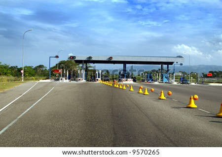 road to toll plaza - stock photo