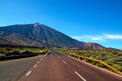 Road towards volcano El Teide at the valley of National Park of Las Canadas,Tenerife.Mount Teide is the Canary Islands most visited tourist attraction.
