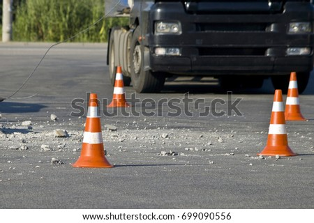 Road traffic cone on the accident site #699090556