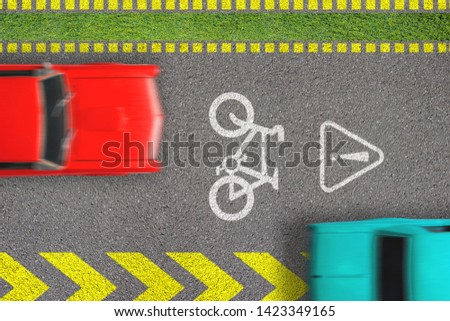 Road traffic offense. Driving by bicycle lane. Concept of biking safety. Top view on road with bike path sign and marks and moving blurred cars on it infracting breaking laws Photo stock ©