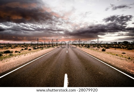 Road travels into the sunset