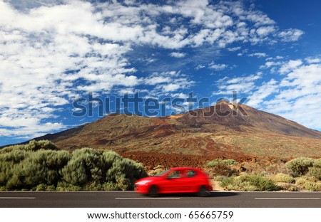 Road trip car in beautiful landscape with copy space. Mountains and volcano Teide, Tenerife in the background