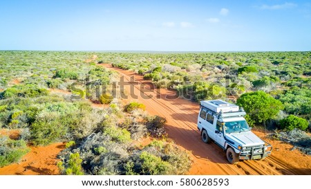 Road trip in Australia, car view from the sky (drone) #580628593