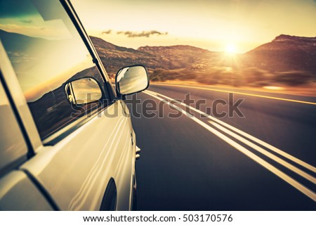 Road trip on sunset, car on the highway, conceptual image of escape and adventure travel, slow motion photo #503170576