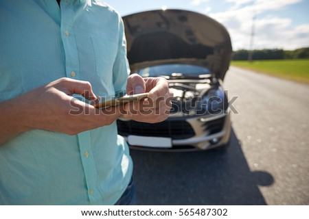 road trip, transport, travel, technology and people concept - close up of man with smartphone and broken car Stock photo ©