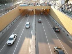 road tunnel under bridge at day