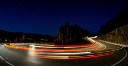 Road turn car light in the night tourism panorama