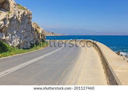 road-turning on the background of the Mediterranean Sea