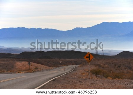 Road twisting among rocks in Nevada