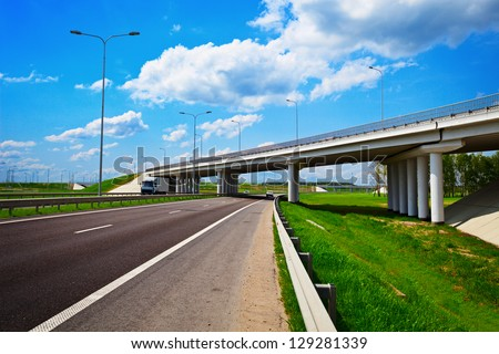 Road under construction. Freeway, overpass and junction with green grass