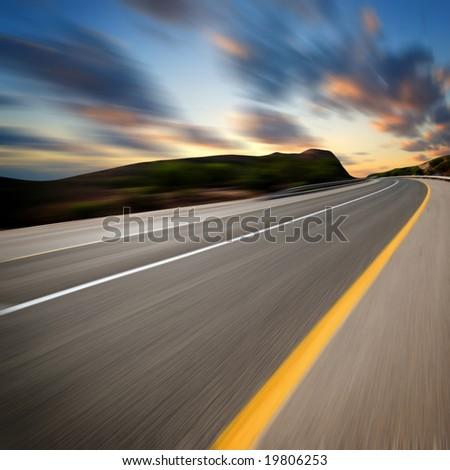road under sunset sky - stock photo