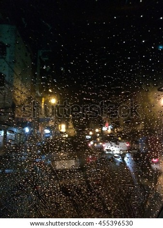 Road view through car window with rain drops #455396530