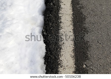 road white lines winter snow danger traffic