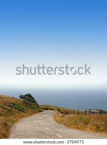 "Road winding down to the ocean on a clear, sunny day. Known as California's ""Lost Coast"" near Cape Mendocino."