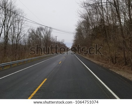 road with and without snow #1064751074