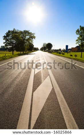 Road with bright sun. Wide angle view.