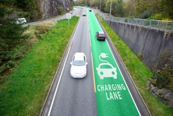 Road with lane for wireless charging of electric vehicles