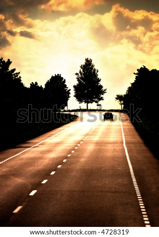 Road with lonely car. Red sunset light and high contrast.