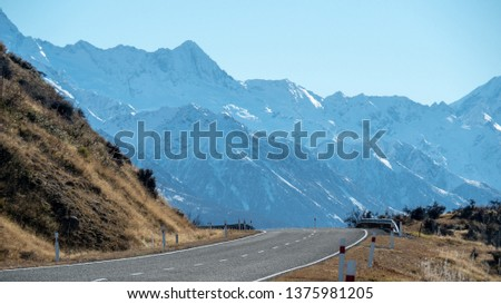 road with snow mountain views #1375981205